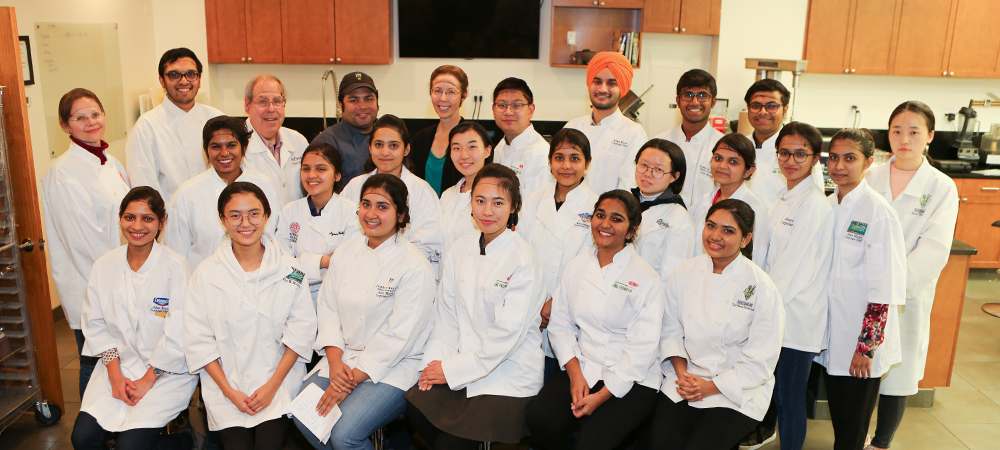 Group pictures of the Illinois Tech Food Science and Nutrition class FdSN 408 / 508 Food Product Development course along with Charlie Baggs Culinary Institute