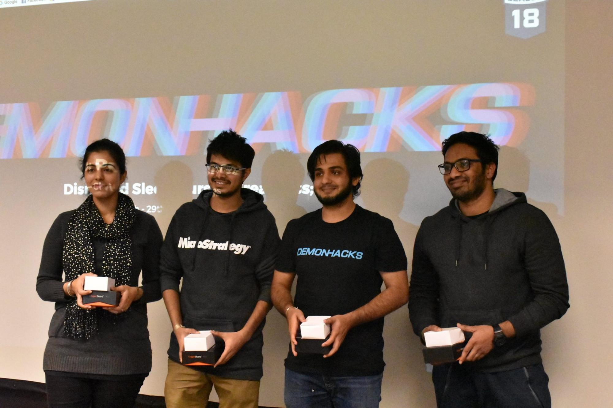 Picture of Illinois Tech Students receiving prize at DemonHack