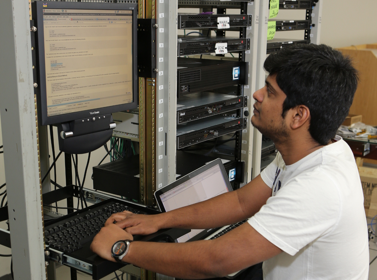 Student at a database console machine