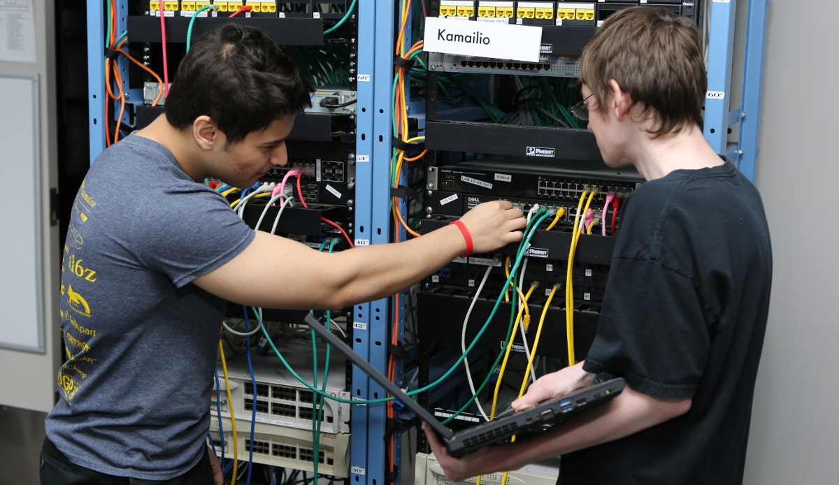Two students fixing servers