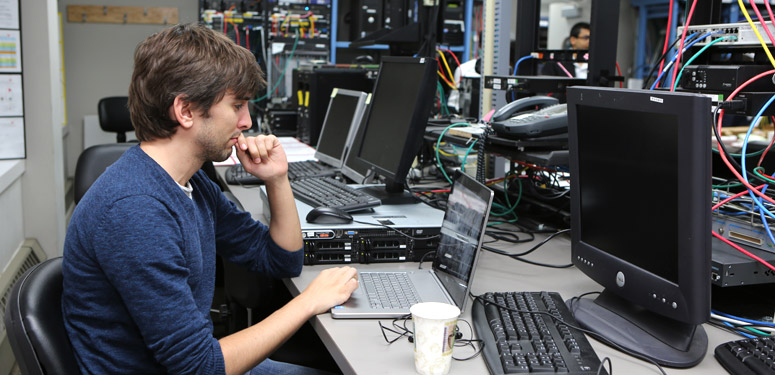 Picture of student doing research in the Real-Time Communications Lab