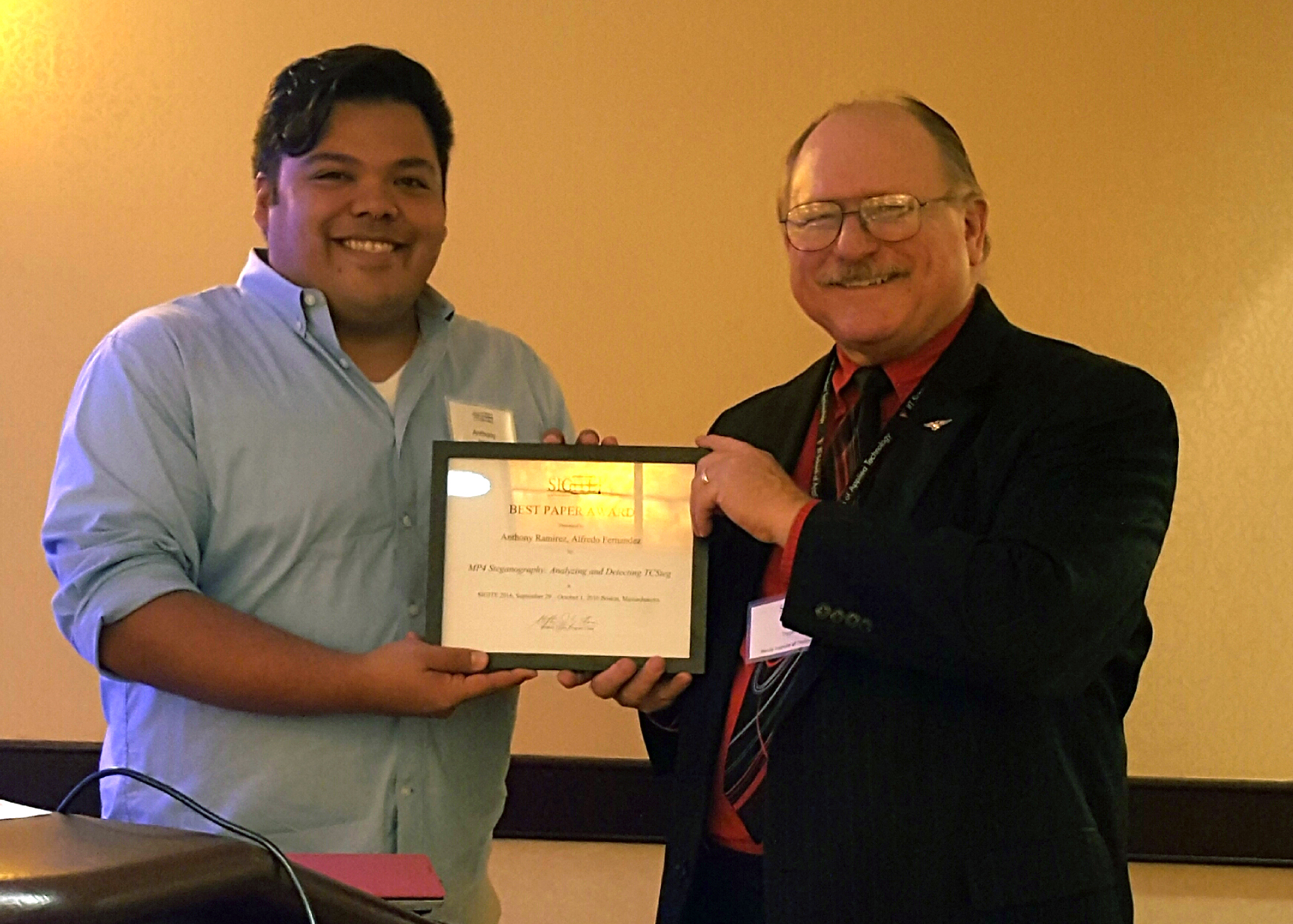 Anthony Ramirez receives the SIGITE Best paper Award